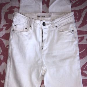 White distress skinny jeans.